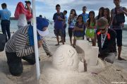 Tourists learn from Globe Sand Castle Making