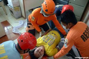 Rescuers perform first aid