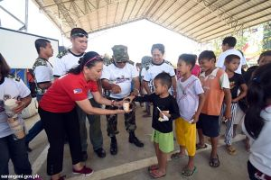 Kiwanis, reservists feed malnourished kids